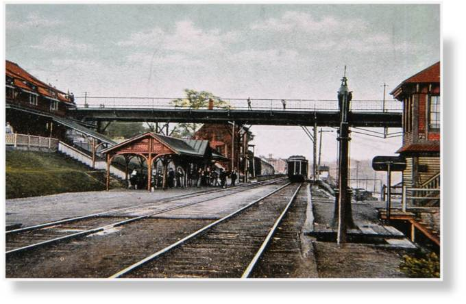Phoenixville station and tower overlooking the iron and steel complex ca. 1910